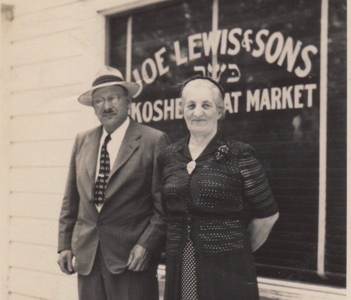 Joe and Lena in front of market